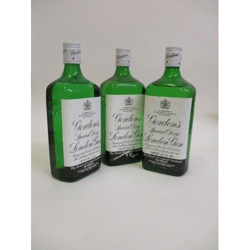 28 - Three bottles of Gordons Special Dry Gin, 26 2/3 fl oz x 3...