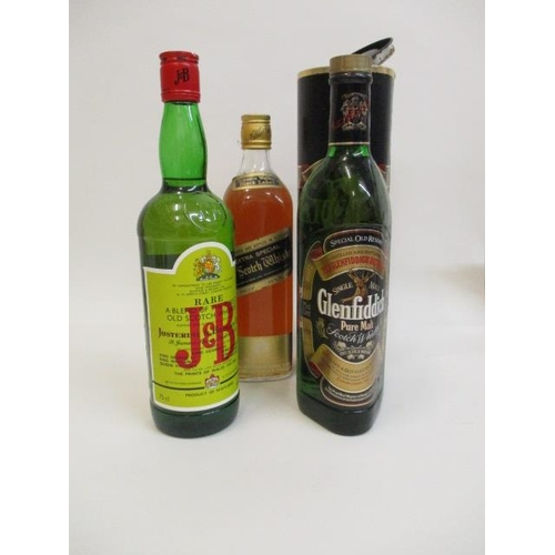 29 - A bottle of J & B Scotch Whisky, a bottle of Johnnie Walker and one bottle of Glenfiddich...