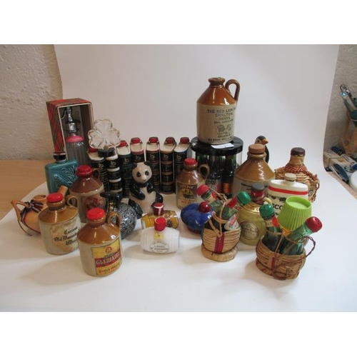 3 - A large collection of miniatures to include Flagens Cornish Mead and a Wade barrel...