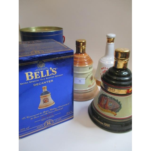 42 - Porcelain decanters from Bell's Scotch whisky...