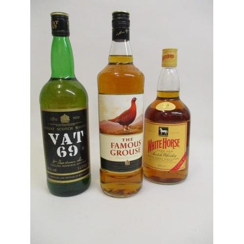 99 - A bottle o f VAT 69 Scotch whisky 1l, a bottle of Famous Grouse whisky 1l and a bottle of White Hors...