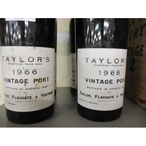 110 - Four bottles of Taylors 1966 vintage port, only partial contents, together with a wooden crate...