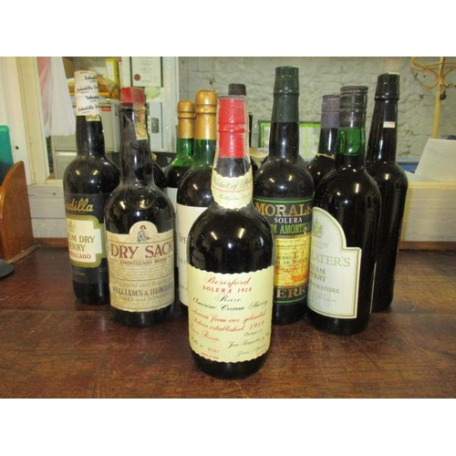 113 - Thirteen bottles of sherry to include Bernsford and Croft...