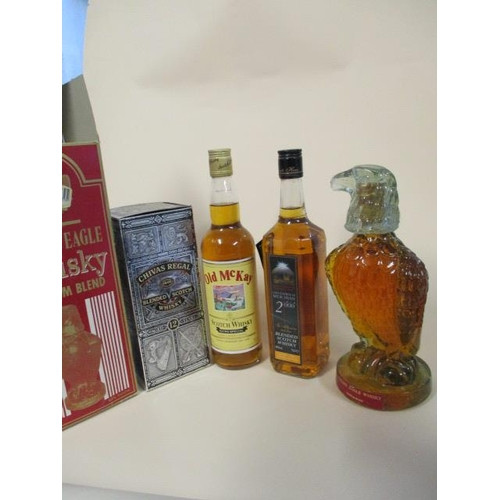 115 - Four bottles of Scotch whisky, to include Old McKay and Golden Eagle...