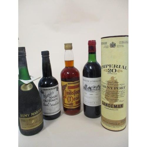 118 - Five bottles to include Remy Martin Cognac and Sandeman Tawny port...
