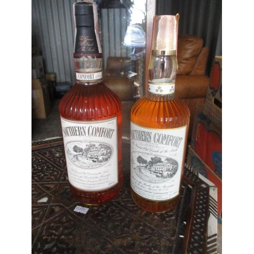132 - Two bottles of Southern Comfort, 1lt and 26 1/2 fl oz...