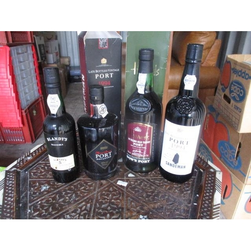 139 - Four bottles of port to include Dow Sandeman and 375ml Blandys Madeira...