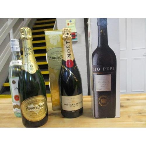 140 - A bottle of Bacardi 750ml, a bottle of Moet & Chandon Champagne, a bottle of Perrier Jouet Champagne...