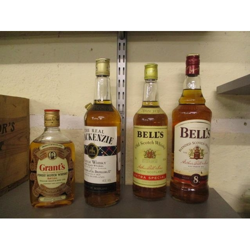 100 - Four bottles of Scotch whisky to include Grants 50cl, Bells 1l and 75ct and the Real Mackenzie 75cl...
