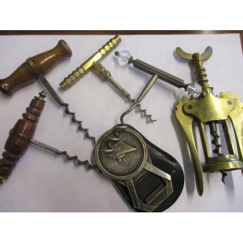 26 - A selection of vintage corkscrews and a bottle opener...