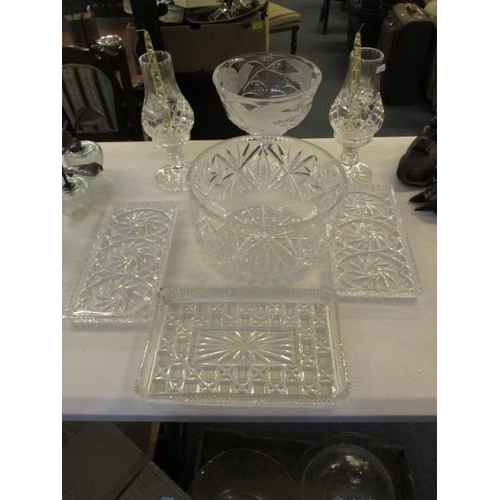 41 - Glassware to include a pair of pedestal storm lamps with line decoration, a large bowl, a pedestal b...