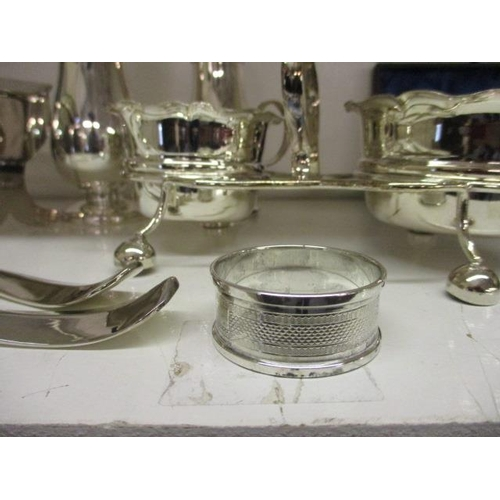 45 - Two silver plated sugar sifters and mixed silver plated table ware, together with a silver napkin ri...