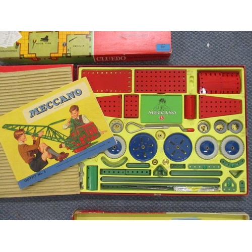 48 - A vintage Meccano Outfit No 5, boxed and two other board games, along with vintage carpet bowls...