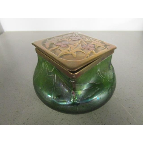 15 - An Art Nouveau Kralik iridescent glass ink well, circa 1905, with a brass and copper collar and lid ...