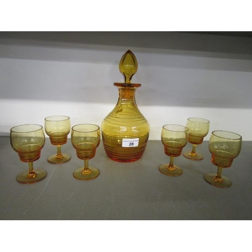 28 - An Art Deco crystal decanter set, designed in the Statford Rings pattern in amber glass, comprising ...