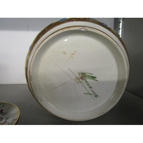 34 - A William Moorcroft for James MacIntyre & Co, a small jardiniere with wavy rim, decorated in the eig...