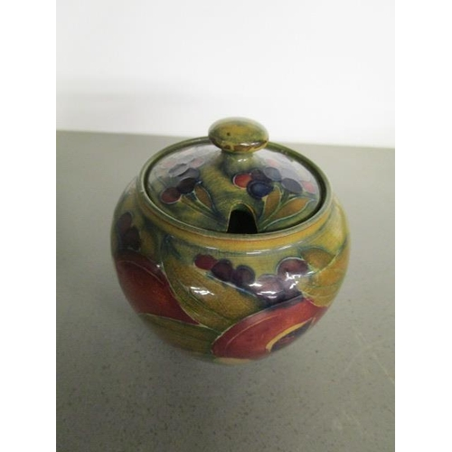 36 - A William Moorcroft Pomegranate pattern preserve pot and cover, having stamped factory marks and dat...