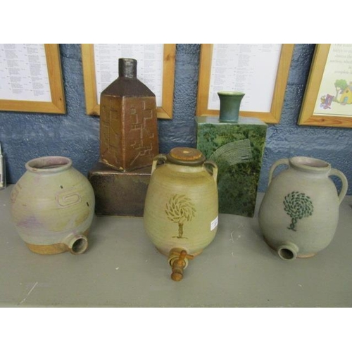 37 - Murial Caley - a group of 1960s studio pottery barrels, a table lamp and a rectangular section bottl...