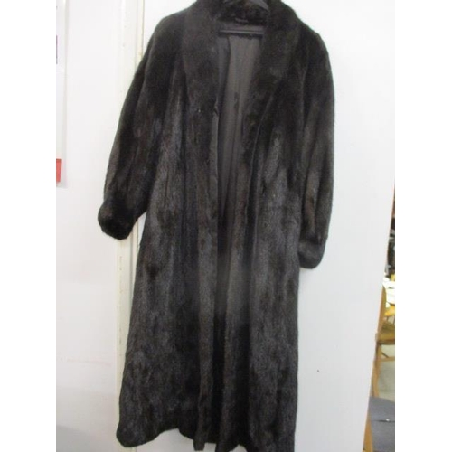 4 - A 1980s ranch mink coat in dark brown, purchased from Cyru Kaye & Co of Goswell Road, London (origin...