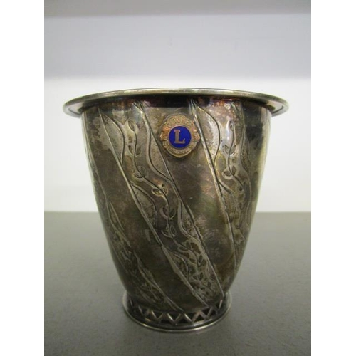 48 - Tage Gothlin for Tesi, Gothenburg, a mid 20th century silver vase with slanted reserves of floral en...