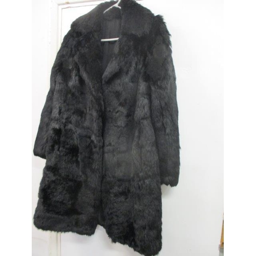 7 - A vintage rabbit fur coat dyed black, knee legth, approximately UK ladies size 12-14, together with ...