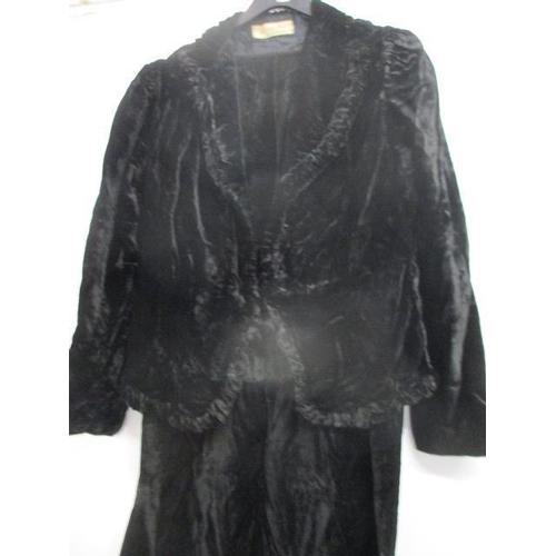 9 - A vintage Harvey Nichols black velvet dress with matching jacket...
