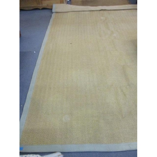 36 - A modern rattan style rug with a pale green banding and a mid 20th century walnut two-tier lamp tabl...
