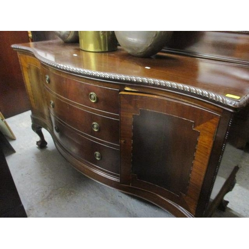 41 - A 1920s matched suite comprising a serpentine fronted sideboard with three central graduated drawers...