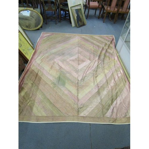 13 - An Indian silk patchwork panel with golden silk thread, lined, fashioned as a tablecloth, (some rest...