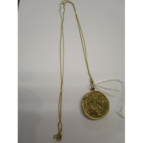 29 - An 18ct gold chain and pendant set with a small diamond, total weight 14g...
