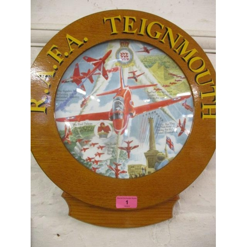 1 - An RAFA Teignmouth Red Arrows pictorial plate, mounted in an oak frame inscribed in gilt letters RAF...