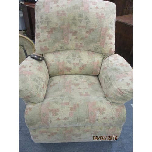 32 - A Sherborne electric recliner in an Aztec style upholstery (Norfolk standard)...
