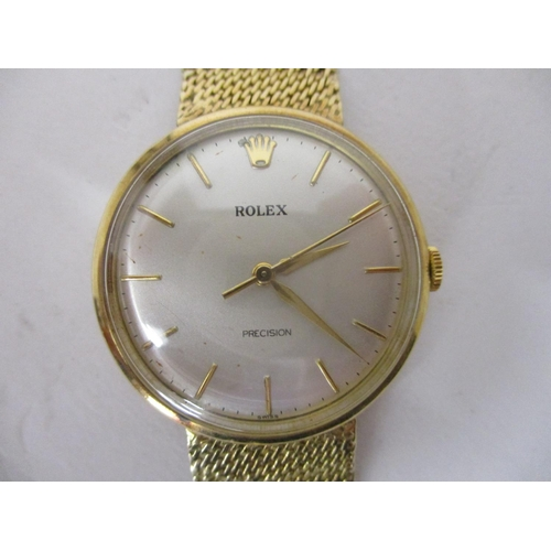 19 - A Rolex 9ct gold gents mechanical wristwatch, with a champagne dial and baton markers, with an integ...