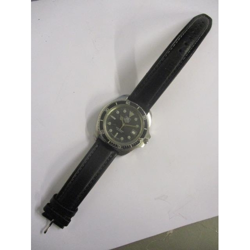 12 - A Tag Heuer gents quartz, stainless steel 1980s divers watch. The black dial having date aperture at...