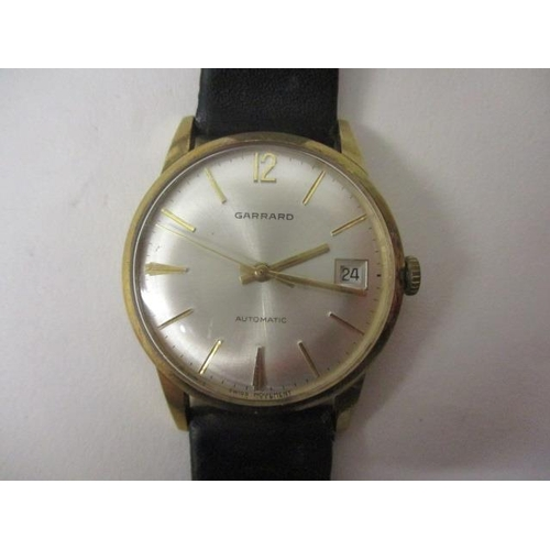 14 - A Garrard gents automatic, 9ct gold 1960s wristwatch. The silvered dial having date aperture at 3 an...