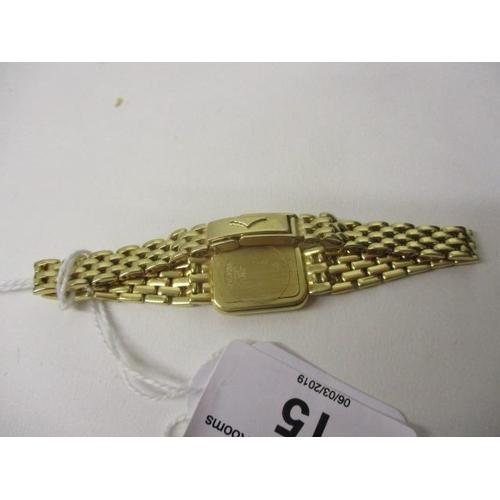 15 - A Longines ladies quartz 18ct gold modern wristwatch. The watch back and original integral bracelet ...