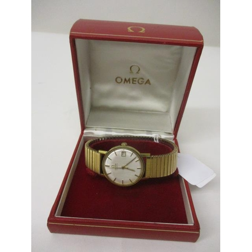 16 - An Omega gents automatic, gold plated, 1960s wristwatch. The silvered dial having date aperture at 3...