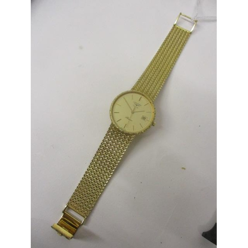 20 - A Longines Presence gents quartz, 9ct gold wristwatch, circa 1999. The gilt coloured dial having dat...