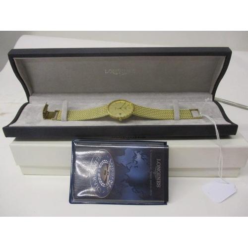 20 - A Longines Presence gents quartz, 9ct gold wristwatch, circa 1999. The gilt coloured dial having dat...