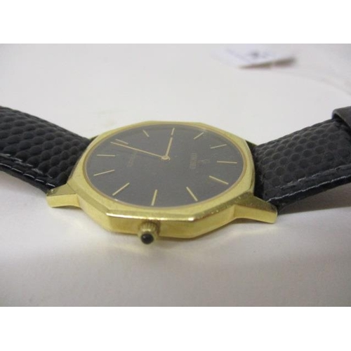 24 - A Concorde gents quartz, 18ct gold wristwatch.  The black dial having gilt batch markers in an octag...