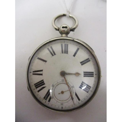 25 - A Victorian silver, open faced pocket watch. The white enamelled dial having Roman numerals and subs...