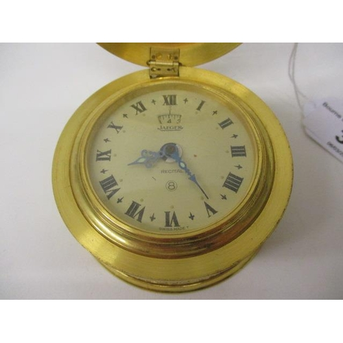 31 - A Jaeger Recital eight day travelling alarm clock in the form of a drum table clock. The dial with R...