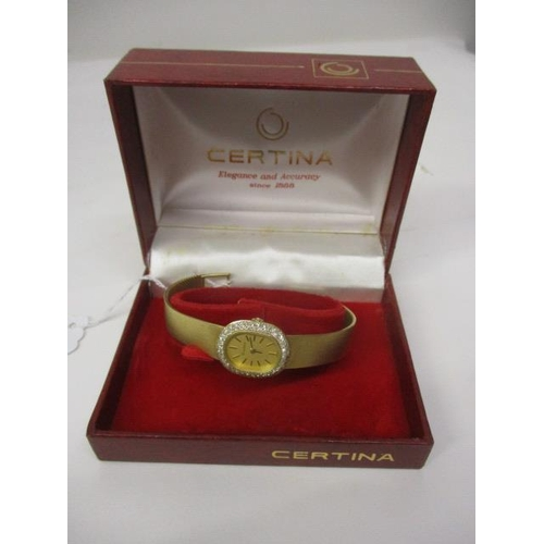 35 - A lady's 18ct yellow gold, hallmarked oval Centina, mechanical integral bracelet watch, having Champ...