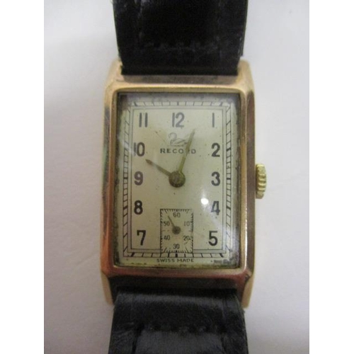 39 - A Record gents manual wind 9ct gold 1930s wristwatch. The dial having Arabic numerals and subsidiary...