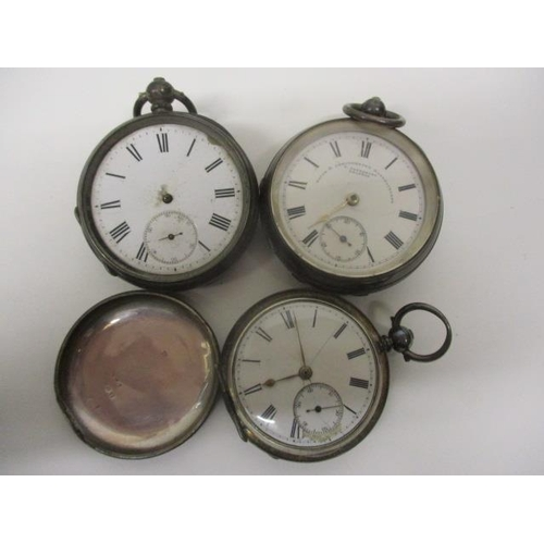 40 - Three silver cased pocket watches to include a later 19th century machine turned, open faced pocket ...