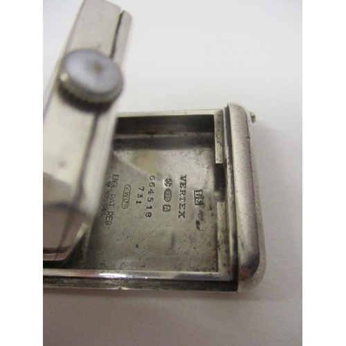 42 - A Fortnum & Mason manual wind, Art Deco Vertex, silver cased purse watch. The square dial having blu...