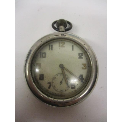 44 - An early 20th century military issue, open faced keyless wind, pocket watch in a protective case. Th...