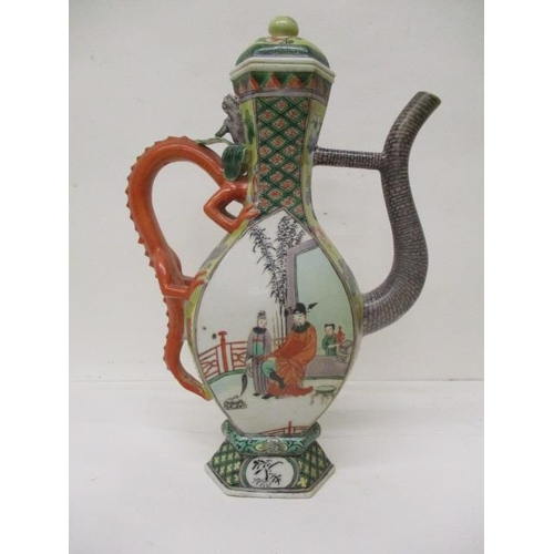 10 - A late 19th century Chinese famille verte hexagonal ewer and cover with a dragon handle, on a splaye...