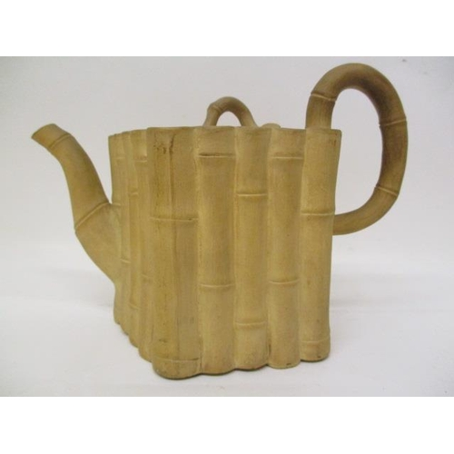 13 - A late 18th century Chinese buff coloured stoneware teapot modelled as a bundle of cut bamboo, with ...