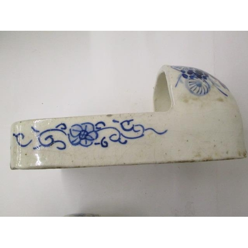 15 - A pair of 19th century Japanese blue and white porcelain geta (slippers) decorated with flowers and ...